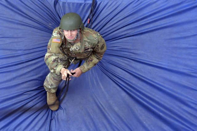 Idaho Army National Guard Spc. Ryan J. Pyfer practices his belaying skills, at the bottom of a 60-foot rappel tower, to provide tension for the descending Soldier above him, as part of a Rappel Master Course, June 12, 2018, at Camp Rilea, near Warrenton, Oregon. More than 40 National Guard Soldiers from across the country attended the weeklong course which was taught by Warrior Training Center instructors from Fort Benning, Georgia, and hosted by the Oregon National Guard.