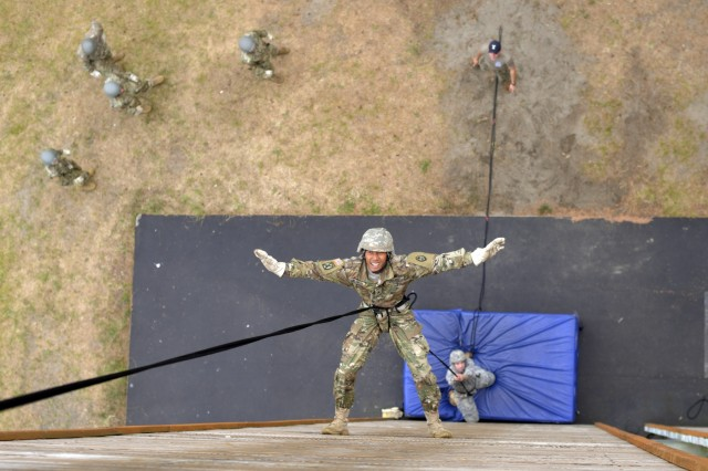 Guam Army National Guard Sgt. Kerman J. Melsior descends down a 60-foot rappel tower as part of the curriculum of a weeklong Rappel Master Course, June 12, 2018, at Camp Rilea, near Warrenton, Oregon. Each Soldier completed a rappel from the tower utilizing the wall before moving on to open-side rappels from the same 60-foot height.