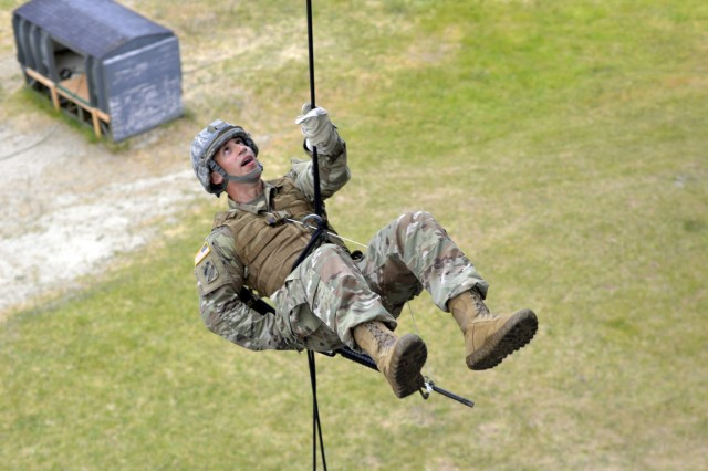 An Army National Guard Soldier completes a semi-combat, open-side rappel off a 60-foot tower during a Rappel Master Course, June 12, 2018, at Camp Rilea near Warrenton, Oregon. Soldiers were required to complete three open-side rappels within 24-hours of their scheduled aircraft command and control test. The test demonstrates the student's ability to successfully send multiple rappelling Soldiers out of a rotary-wing aircraft at approximately 90-feet above ground.