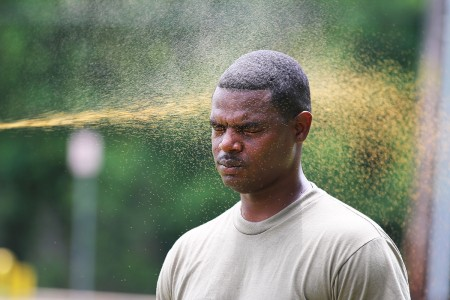 A Soldier assigned to the Virgin Islands National Guard, is sprayed with oleoresin capsicum (OC) spray as he prepares to begin an OC and X26 series taser obstacle course at Fort Polk, La., June 21, 2018.