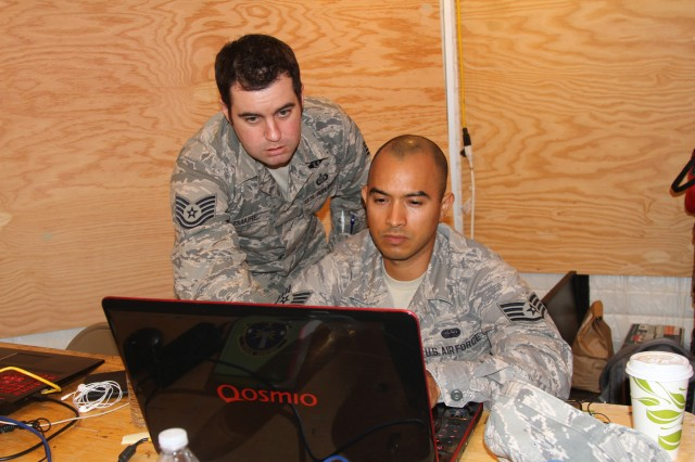 U.S. Air Force Tech Sgt. Matthew LeMaire and Staff Sgt. Marlon Ramos of the California Air National Guard's 195th Air Base Wing provide intelligence information July 28 to the California Department of Forestry and Fire Protection (CAL FIRE) during the Carr Fire in Shasta County, California. The airmen daily provide key data CAL FIRE uses to battle the serious fire that destroyed 500 structures in less than a week.