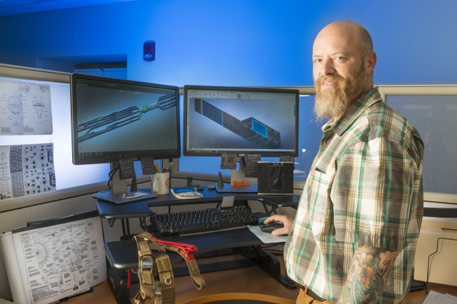 Robert Galyan -- a drafter on the Technical Services Team at the Natick Soldier Research, Development and Engineering Center -- works on a technical data package, or TDP. TDPs include technical drawings, as well as other information, that drive the design, prototyping, and manufacturing of a wide range of warfighter equipment.