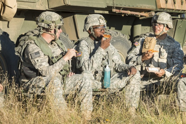 Soldiers enjoy Meals, Ready-to-Eat (MRE) pizza during initial field testing of the product in 2014. To ensure taste and quality, every item that goes into an MRE ration is extensively taste-tested by Soldiers in the field.