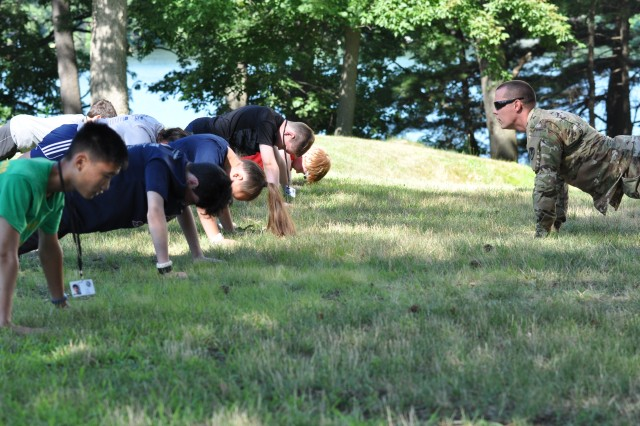 "37 students from the Natick Junior Police Academy became ""Soldiers for a Day"" during their visit to Natick Soldier Systems Center (NSSC) in July 2018. Exercises included unit PT, trying on uniforms, and building and eating rations with the Combat Feeding Directorate (CFD) of Natick Soldier Research, Development and Engineering Center (NSRDEC)."