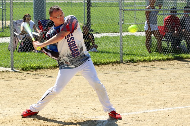 A batter eyes the ball and he swings the bat during the softball tournament Aug. 17, 2017, as part of Victory Week 2017. (Chad L. Simon, 1st Inf. Div. Public Affairs)