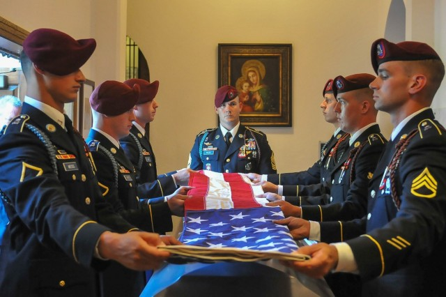 The flag of the United States is folded over the casket of the late retired 1st Sgt. Harold Eatman by paratroopers of the 2nd Battalion, 505th Parachute Infantry Regiment on July 11, 2018 at the Cathedral of Saint Patrick in Charlotte, North Carolina as 1st Sgt. James Miller of Company B, 2-505 PIR, center, looks on.  Eatman was a member of the 505th PIR and conducted four World War II combat jumps into Sicily, Salerno, Normandy and Holland with the regiment.  He died earlier in July at the age of 102.