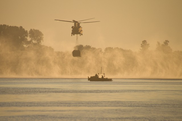 A Marine Corps CH-47 Chinook airdrops an interior bridge bay during River Assault 2018 on the Arkansas River near Fort Smith, Ark., July 25, 2018. The annual exercise brought together Marine Corps and Army units for one of the largest Army Reserve engineer exercises in the country.