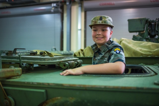 FORT BENNING, Ga. (July 30, 2018) - Nine-year-old military enthusiast Eli Wilson visited locations throughout Fort Benning, Georgia, July 26. Wilson, who has Asperger's syndrome, ate lunch at a dining facility with Delta Company, 1st Battalion, 46th Infantry Regiment, attended a basic training graduation, visited the National Infantry Museum, and met with the 316th Cavalry Brigade to see an M1126 Stryker Combat Vehicle and an M1 Abrams Main Battle Tank. (U.S. Army photo by Patrick Albright, Maneuver Center of Excellence, Fort Benning Public Affairs)