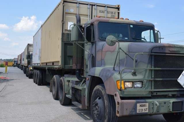 Army National Guard Soldiers conduct a line haul from an east coast port to Crane Army Ammunition Activity during Operation Patriot Bandoleer June 2 to July 25, 2018. This operation benefits the Army by providing hands-on training for Soldiers and cost savings to the organic industrial base. Soldiers worked alongside Crane Army personnel during the transfer of containers and munitions.