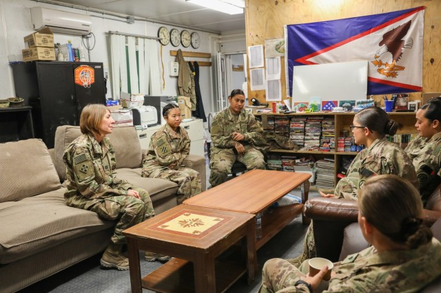 Capt. Kelly Drake, behavioral health officer for the 2nd Infantry Brigade Combat Team, 4th Infantry Division, far left, talks to Soldiers about stress management, July 11, 2018, in Kandahar Airfield, Afghanistan. Drake and Sgt. Kert Lang, behavioral health noncommissioned officer for 2IBCT, 4th Inf. Div., provided classes for service members throughout the airfield to help mitigate stressors that could arise. (U.S. Army photo by Staff Sgt. Neysa Canfield/ TAAC-South Public Affairs)