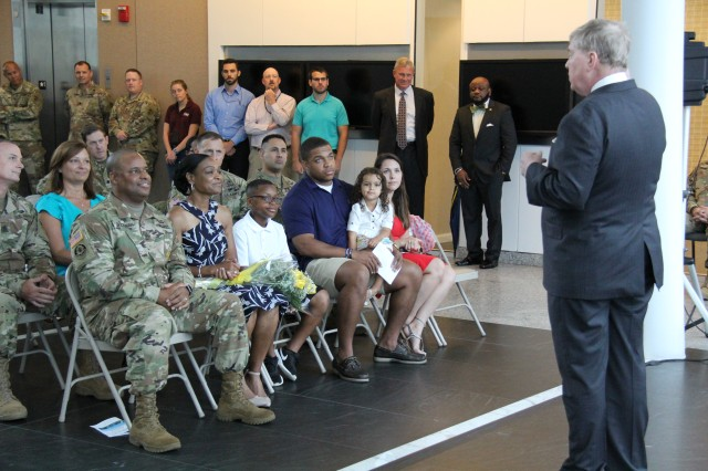 The U.S. Army Evaluation Center, or AEC, Director, James C. Cooke welcomes the incoming sergeant major of AEC, Sgt. Maj. Michael A. Goodman and his family during the change of responsibility ceremony July 17.