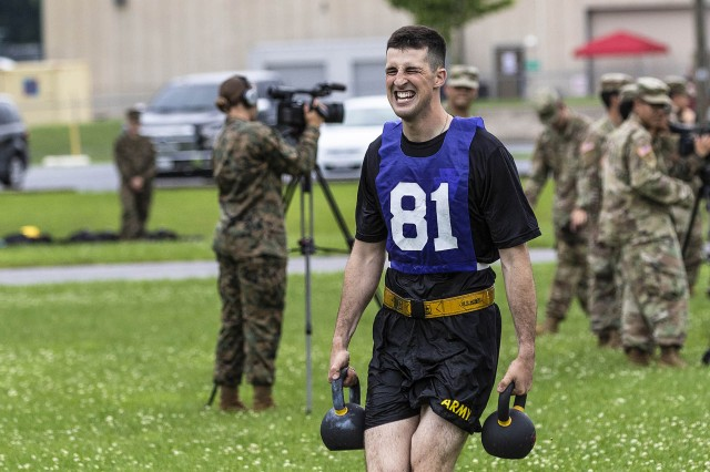 U.S. Army Spc. Bailey Ruff with the South Dakota National Guard sprints with two kettlebells during a physical fitness test July 24, 2018, at the 2018 National Best Warrior Competition in Fort Indiantown Gap, Pennsylvania.