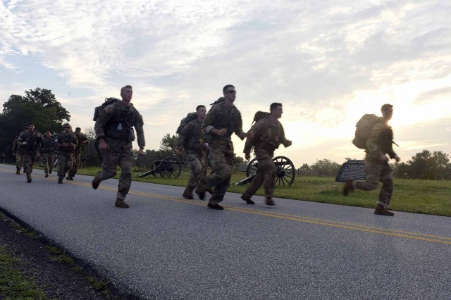 U.S. Army Spc. Bailey Ruff with the South Dakota National Guard, center, runs along a road at Gettysburg National Military Park as part of the last event in the 2018 Army National Guard Best Warrior Competition, July 27, 2018.