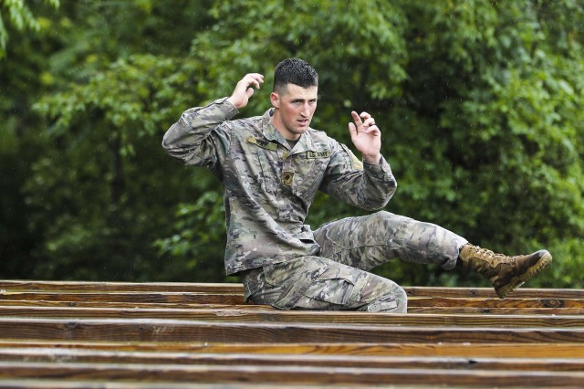 U.S. Army Spc. Bailey Ruff with the South Dakota National Guard competes in the Army National Guard Best Warrior Competition and practices traversing an obstacle during a familiarization run on an obstacle course prior to competing for time at the 2018 Army National Guard Best Warrior Competition at Fort Indiantown Gap, Pennsylvania, July 24, 2018.