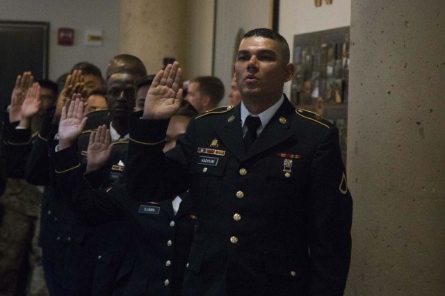 Pvt. 1st Class Yasir Kadhum recites the Naturalization Oath of Allegiance to the United States during a naturalization ceremony at Fort Hood, Texas, July 17, 2018.