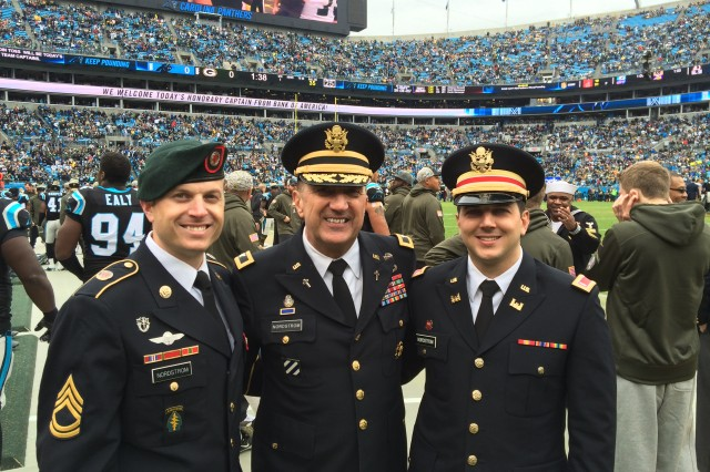 "From left to right, Sgt.1st Class Philip Nordstrom, Col. Mark Nordstrom and 1st Lt. Joel Nordstrom enjoyed a day at a Carolina Panthers ""Salute to Service"" football game where Col. Nordstrom gave the opening invocation before the game."