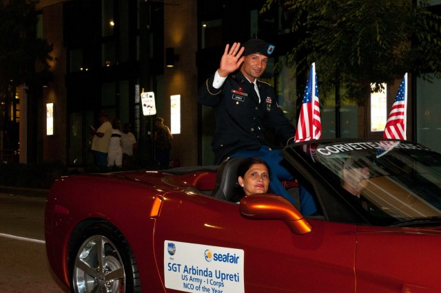 Sgt. Arbinda Upreti, of 14th Brigade Engineer Battalion, 2nd Stryker Brigade Combat Team, 7th Infantry DIvision is accompanied by his mother Sita Upreti during the 68th Annual Seafair Parade, Seattle, July 28, 2018. Upreti is America's First Corps Noncommissioned of the Year. Upreti competed against 38 other Soldiers from across from across I Corps and finished above the rest in events that tested critical thinking, physical fitness and warrior tasks and battle drills. Winning secured him the honor of representing I Corps in the parade., (U.S. Army photo by Sgt. Youtoy Martin, 5th Mobile Public Affairs Detachment)