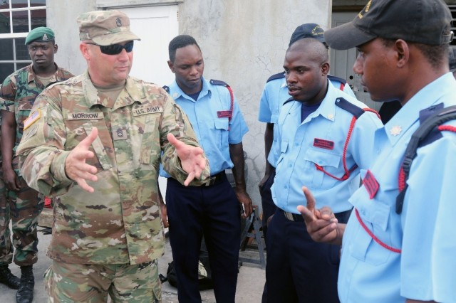 Sgt. 1st Class Alden C. Morrow, with the Florida National Guard's C-ERFP, instructs members of the St. Kitts and Nevis fire department. Morrow and his four-person team are supporting the State Partnership Program by training local emergency response agencies on search and extraction operations in St. Kitts and Nevis, July, 26 2018.