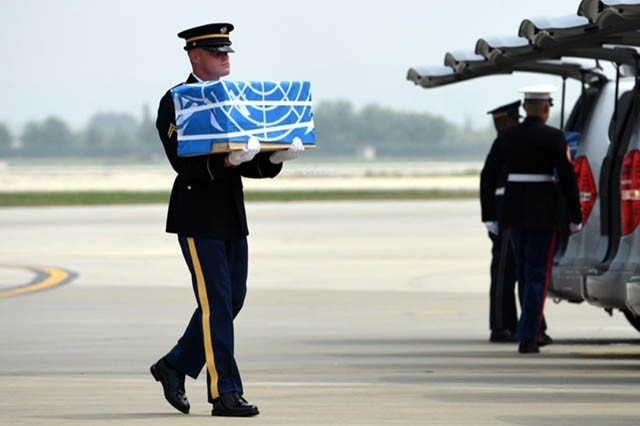 Remains are carried during a dignified return ceremony at Osan Air Base, South Korea, July 27, 2018.