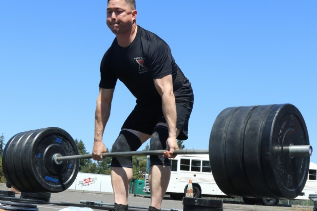 """Sgt. Maj. Stephen Helton, command sergeant major, 7th Infantry Division, performs a deadlift during the Bayonet Warrior Athlete Program's """"Svehla"""" Max Deadlift challenge at the 7th Infantry Division Headquarters building at Joint Base Lewis-McChord, Wash., July 27, 2018. The event, named in honor of 7th Infantry Division Medal of Honor awardee, PFC Henry Svehla pitted the contestants against each in order to determine the maximum weight lifted in comparison to their bodyweight."""