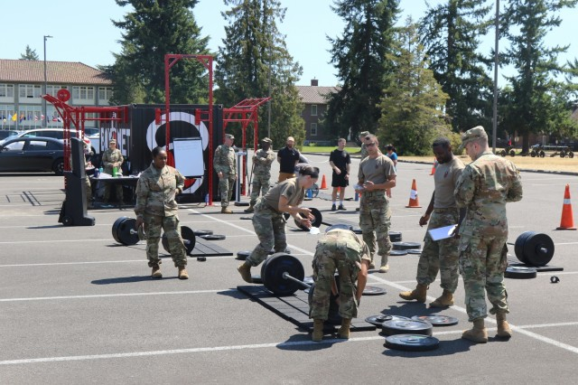 """Bayonet Warrior Athlete Program cadre, set up the weights for the """"Svehla"""" Max Deadlift challenge at the 7th Infantry Division Headquarters building on Joint Base Lewis-McChord, Wash., July 27, 2018. The event, named in honor of 7th Infantry Division Medal of Honor awardee, PFC Henry Svehla pitted the contestants against each in order to determine the maximum weight lifted in comparison to their bodyweight."""