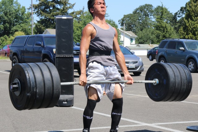 """Weighing in at 122 lbs., 16 year-old, Justin Madarang, a civilian dependent, performs a deadlift of 425 lbs., during the Bayonet Warrior Athlete Program's """"Svehla"""" Max Deadlift challenge at the 7th Infantry Division Headquarters building at Joint Base Lewis-McChord, Wash., July 27, 2018. The event, named in honor of 7th Infantry Division Medal of Honor awardee, PFC Henry Svehla pitted the contestants against each in order to determine the maximum weight lifted in comparison to their bodyweight."""