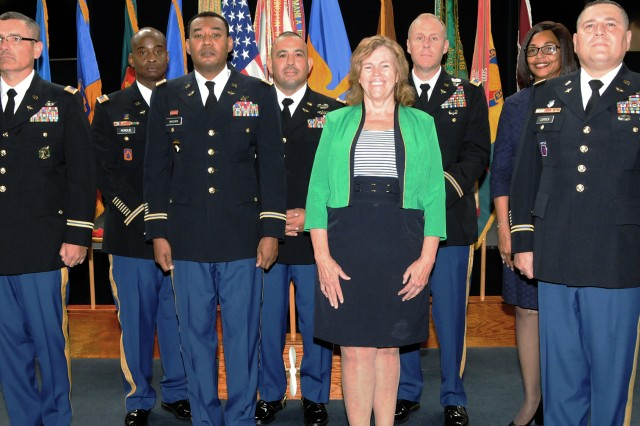 With a combined 413 years of service, 14 Soldiers and two civilians retired during the Fort Rucker Quarterly Retirement Ceremony July 27 in the U.S. Army Aviation Museum. The retirees: (back row) CW3 Dana J. Perdue, CW4 Miguel A. Toledo-Diaz, CW4 Brian F. Murray and Theresa Barnette; (front row) CW5 Virgil G. Martin Jr., CW4 Derrick S. Brown, Joy Moseley and CW4 Jorge Correa.