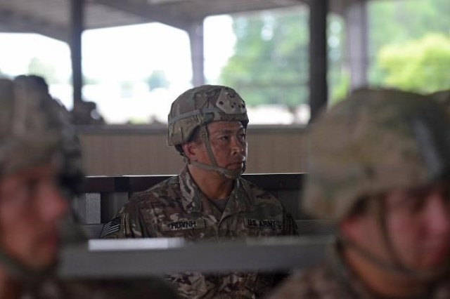 Command Sgt. Maj. Thinh Huynh, the senior enlisted advisor of 1st Battalion, 504th Parachute Infantry Regiment, 1st Infantry Brigade Combat Team, 82nd Airborne Division, prepares to conduct pre-jump training during Operation Devil Storm at Green Ramp, Fort Bragg, N.C., July 17, 2018.