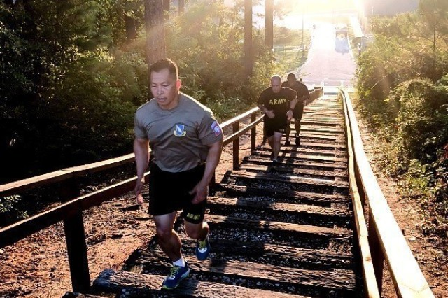 Command Sgt. Maj. Thinh Huynh runs upstairs during physical training at Fort Bragg, N.C., Aug. 1, 2018.