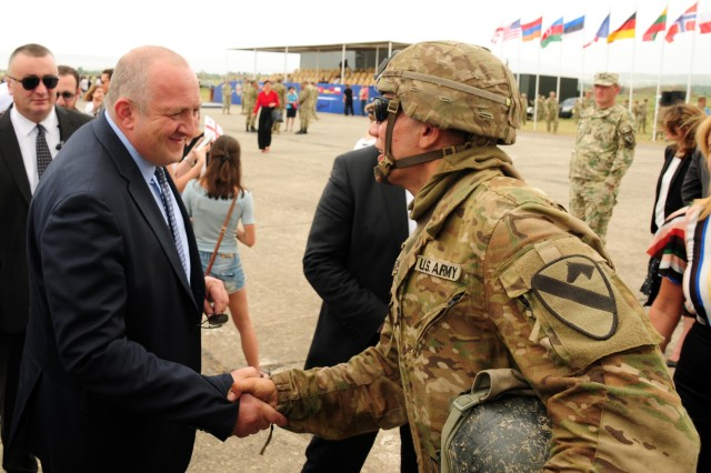 President of Georgia Giorgi Margvelashvili shakes the hand of U.S. Army Pvt. Nicholas Cardone, a Soldier assigned to Charlie Company, 2nd Battalion, 5th Cavalry Regiment, 1st Armored Brigade Combat Team, 1st Cavalry Division, at the opening ceremony of Noble Partner 2018 at Vaziani Air Strip, Georgia, Aug. 1, 2018.
