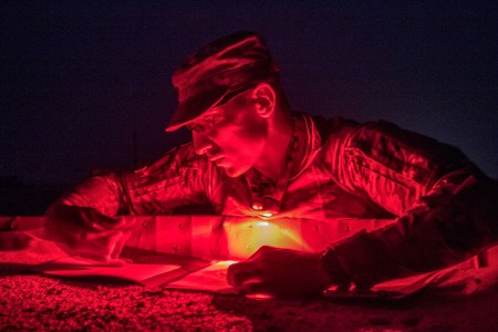 A military policeman attached to U.S. Army Central, plots his points for the land navigation event during U.S. Army Central's 2018 Best Warrior Competition at Forward Operating Base Gerber, Kuwait, June 29, 2018.