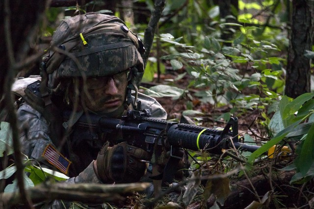 A cadet from 7th Regiment Advanced Camp aims his weapon toward the objective during guard duty.