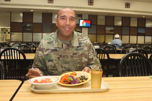 Chief Warrant Officer 2 Jeremy Patterson shows a plate of food loaded with color and nutrition at the Guns and Rockets Dining Facility at Fort Sill, Okla. The food service adviser to the 75th Field Artillery Brigade commander finds a plant-based diet agreeable to his soldierly duties.