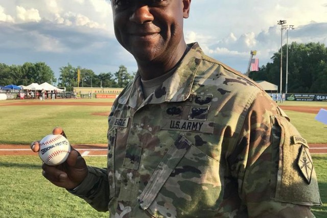 """Brig. Gen. Milford """"Beags"""" Beagle Jr., Fort Jackson commander, shows off a baseball moments before he threw out the ceremonial first pitch at the Lexington Blowfish's Military Appreciation Day baseball game July 28."""