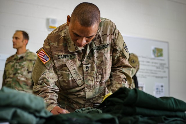 Sgt. Roel Sardea, a logistics specialist with the 176th Engineer Company, inventories the new equipment he received prior to going to help fight wildfires impacting eastern Washington, Wednesday, Aug. 1, 2018 at Camp Murray, Washington.