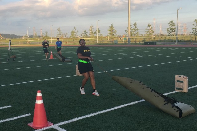 CAMP HUMPHREYS, Republic of Korea - 1st Sgt. Sherri Nobles, 1st Armored Brigade Combat Team, 3rd Infantry Division executes the 250-meter Sprint, Drag, and Carry as part of a demonstration of the new Army Combat Fitness Test during a leadership professional development event.