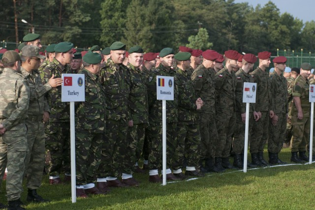 Soldiers from Turkey, Romania, Poland and Norway stand in formation in preparation for an opening ceremony marking the official beginning of Exercise Rapid Trident 2017 at the Yavoriv Combat Training Center on the International Peacekeeping and Security Center in Western Ukraine on Sept. 11, 2017.
