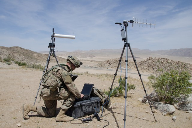 Pfc. Nathaniel Ortiz of the 780th Military Intelligence Brigade sets up deployable cyber tools overlooking the mock city of Razish at the National Training Center at Fort Irwin, Calif., May 5, 2017.