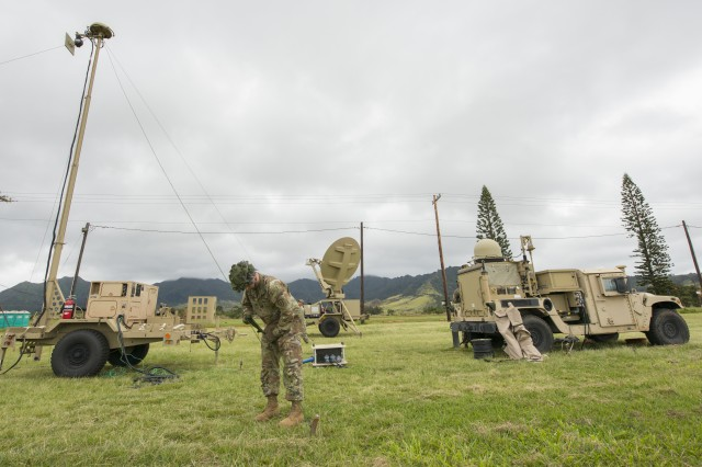 Sgt. Cody McCarty, assigned to the 25th Infantry Division's 2nd Infantry Brigade Combat Team, helps set up the Warfighter Information Network-Tactical system's new lighter version during a training exercise at Schofield Barracks, Hawaii, March 13, 2018. The Army recently held a technical forum with industry partners to find solutions that could one day improve tactical network capabilities and make it easier for Soldiers to perform distributed mission command.
