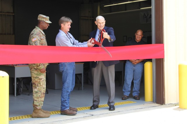 FORT BENNING, Ga. (Aug. 3, 2018) - U.S. Army Garrison Fort Benning Command Sgt. Maj. Connie Rounds; Dave Schulgen, CEO and assistant chairman of Airstreams Renewables; George Steuber, USAG Fort Benning deputy to the commander; and Felix Cruz, training supervisor, prepare to cut a ribbon during the opening of a new career skills program. The Fort Benning Career Skills Program (CSP) launched a new course in the burgeoning field of renewable energy for transitioning Soldiers and veterans at Kelley Hill at Fort Benning, Georgia, July 30, 2018. (U.S. Army photo by Cristina Piosa, Maneuver Center of Excellence, Fort Benning Public Affairs)