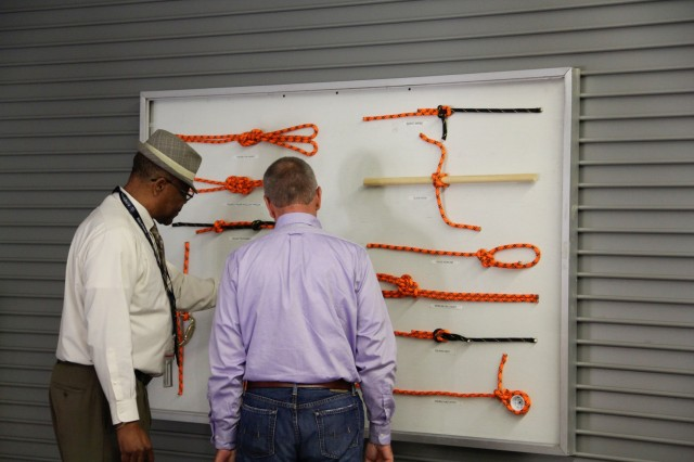 FORT BENNING, Ga. (Aug. 3, 2018) - Charles Williams and Ralf Bremer observe the various knot-tying techniques at the Airstream Renewables career skills program ribbon-cutting event. The Fort Benning Career Skills Program (CSP) launched a new course in the burgeoning field of renewable energy for transitioning Soldiers and veterans at Kelley Hill at Fort Benning, Georgia, July 30, 2018. (U.S. Army photo by Cristina Piosa, Maneuver Center of Excellence, Fort Benning Public Affairs)