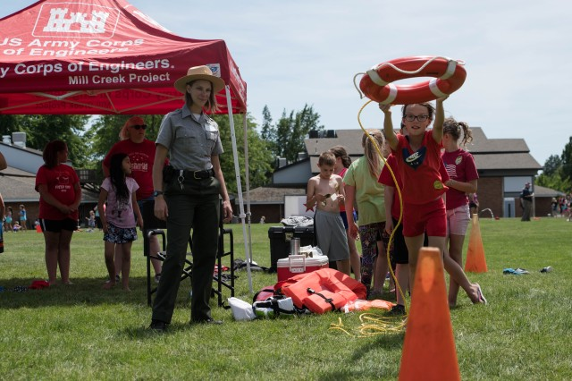 "U.S. Army Corps of Engineers, Walla Walla Districts, Park Tech Sandy Hattan teaches children ""Reach, Throw, Row, Don't Go!"" at the Water Safety Station during the Prospect Point Elementary School Field Day, Walla Walla, Wash. Corps personnel volunteered at the primary school and showed support to Walla Walla community youth with a Water Safety activity and play through Science, Technology, Engineer and Math."
