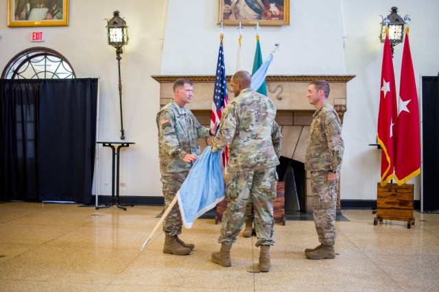 FORT BENNING, Ga. (Aug. 3, 2018) - Maj. Gen. Gary M. Brito, center, the Maneuver Center of Excellence, hands the U.S. Army Infantry School colors to Brig. Gen. David M. Hodne, left, the new commandant of the Infantry School. The MCoE held a change of responsibility for the Infantry School Aug. 3 at the Benning Club at Fort Benning, Georgia, welcoming Hodne. Col. Townley R. Hedrick, right, who served as the commandant of the Infantry School since May, is staying on as the deputy commandant. (U.S. Army photo by Patrick Albright, Maneuver Center of Excellence, Fort Benning Public Affairs)