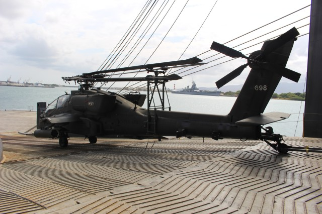 Transporters upload a 25th Combat Aviation Brigade Apache helicopter onto the M/V Green Lake during port operations at Pearl Harbor on July 19.