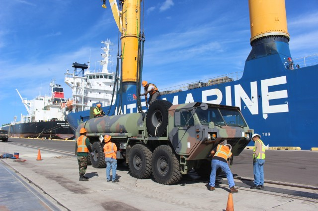 Transporters prepare a fuel hauler to be lifted onto the M/V Ocean Jazz during port operations at Barbers Point Harbor on July 21.