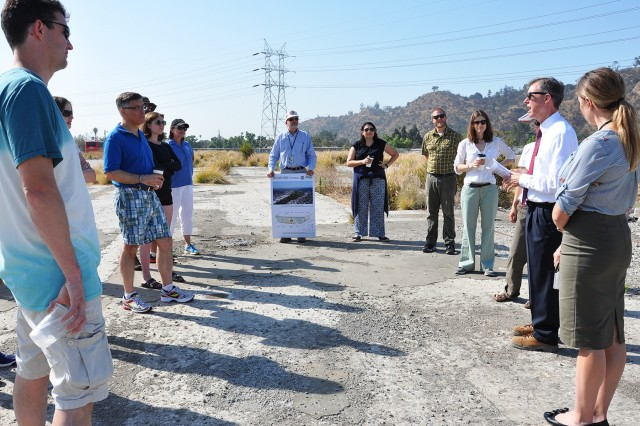 Gary Lee Moore, Los Angeles city engineer, second from right, talks to students and instructors with the U.S. Army Corps of Engineers Planning Associates Program about plans for ecosystem restoration along the Los Angeles River during the group's July 25 bus tour of Los Angeles County watersheds.