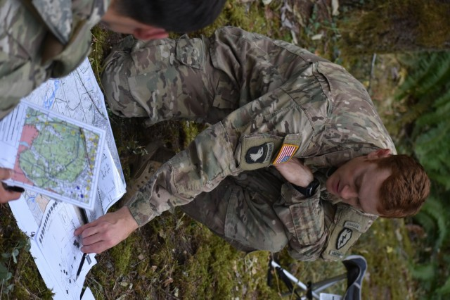 Capt. Alex Purdy, Charger Company Commander from 1st Battalion 5th Infantry Regiment, briefs his platoon leaders during Emergency Deployment Readiness Exercise Courage Ready 18-02 at Joint Base Lewis McChord, Aug. 2. C/ 1-5 Infantry deployed from Fort Wainwright, Alaska, to join the 4th Battalion, 23d Infantry Tomahawks for iteration two of America's First Corps Courage Ready series which provides an opportunity for all units involved to exercise critical skills both in planning and execution of the mission.
