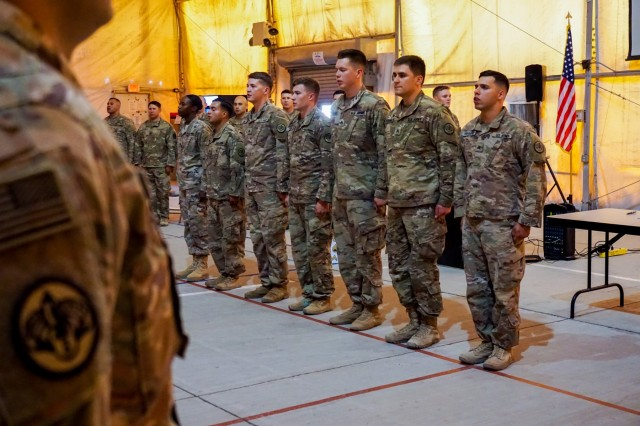 "New inductees from 1st Squadron, 3rd Cavalry Regiment ""Brave Rifles,"" recite the Creed of the Non-Commissioned Officer during an NCO induction ceremony in Iraq August 3, 2018. Brave Rifles troopers are deployed to Iraq in support of Combined Joint Task Force Operation Inherent Resolve, working by, with and through the Iraqi Security Forces and coalition partners to defeat ISIS in Iraq and Syria."