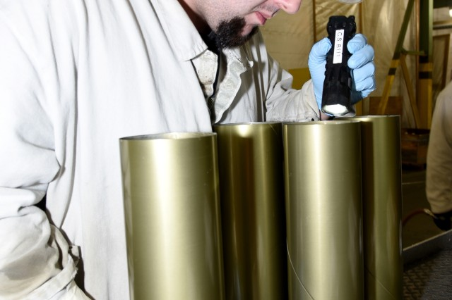 Matt Kuykendall, an Industrial Operations Division employee at McAlester Army Ammunition Plant, Okla., inspects the inside of a 105mm artillery case to ensure it is clean and ready for painting, which is the final step in the case renovation process. The cases are then sent to another building on the installation where they are loaded, assembled and packed as if they were new. The Lean Six Sigma case renovation project is expected to produce approximately $1,878,463 in cost savings benefits over seven years.