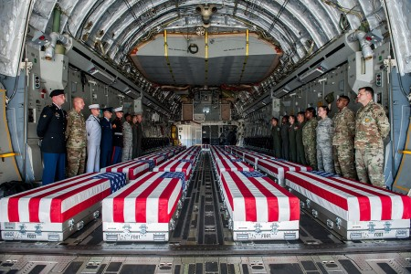 Transfer cases, containing the remains of what are believed to be U.S. service members lost in the Korean War, line the bay of a U.S. Air Force C-17 Globemaster III aircraft during an honorable carry ceremony at Joint Base Pearl Harbor-Hickam, Hawaii, Aug. 1, 2018. The ceremony marked the arrival of 55 transfer cases recently repatriated from North Korea. The Defense POW/MIA Accounting Agency will receive the remains to start the identification process.